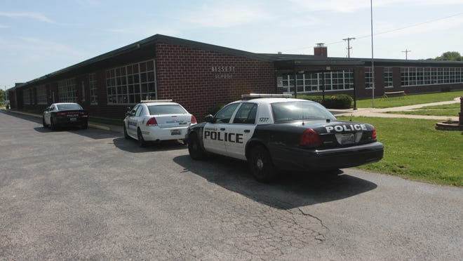 Police investigate what was reported as an abduction of a young girl from in front of the school.