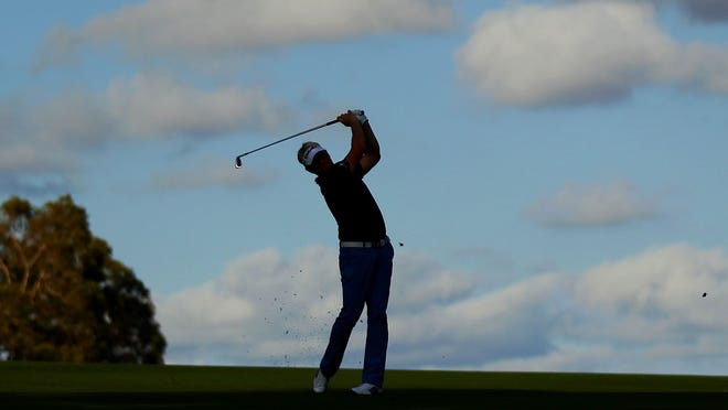 Peter Hedblom plays his approach shot on the 18th hole during day two of the Perth International.