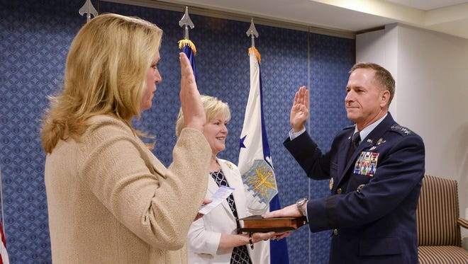 Air Force Secretary Deborah Lee James reads the oath of office to Air Force Chief of Staff Gen. David L. Goldfein as his wife, Dawn, holds the chief of staff Bible during a swearing-in ceremony at the Pentagon in Washington, D.C., July 1. Goldfein became the 21st chief of staff of the Air Force.