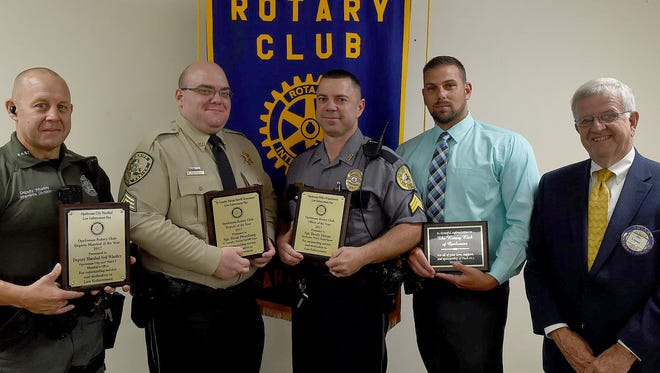 The Opelousas Rotary Club selected their 2017  outstanding police officer Tuesday at their weekly luncheon held at Opelousas General Health System South Campus. From left are Deputy Marshal Neil Whatley,  Sgt. Ryan Pressburg of the St. Landry Parish Sheriff's Department,  Sgt. Brody Ortego of the Opelousas Police Department and Detective Michael Darbonne of the St. Landry Parish Sheriff's Department. Pictured presenting the awards is Opelousas Rotary Club member Jim Lopez.