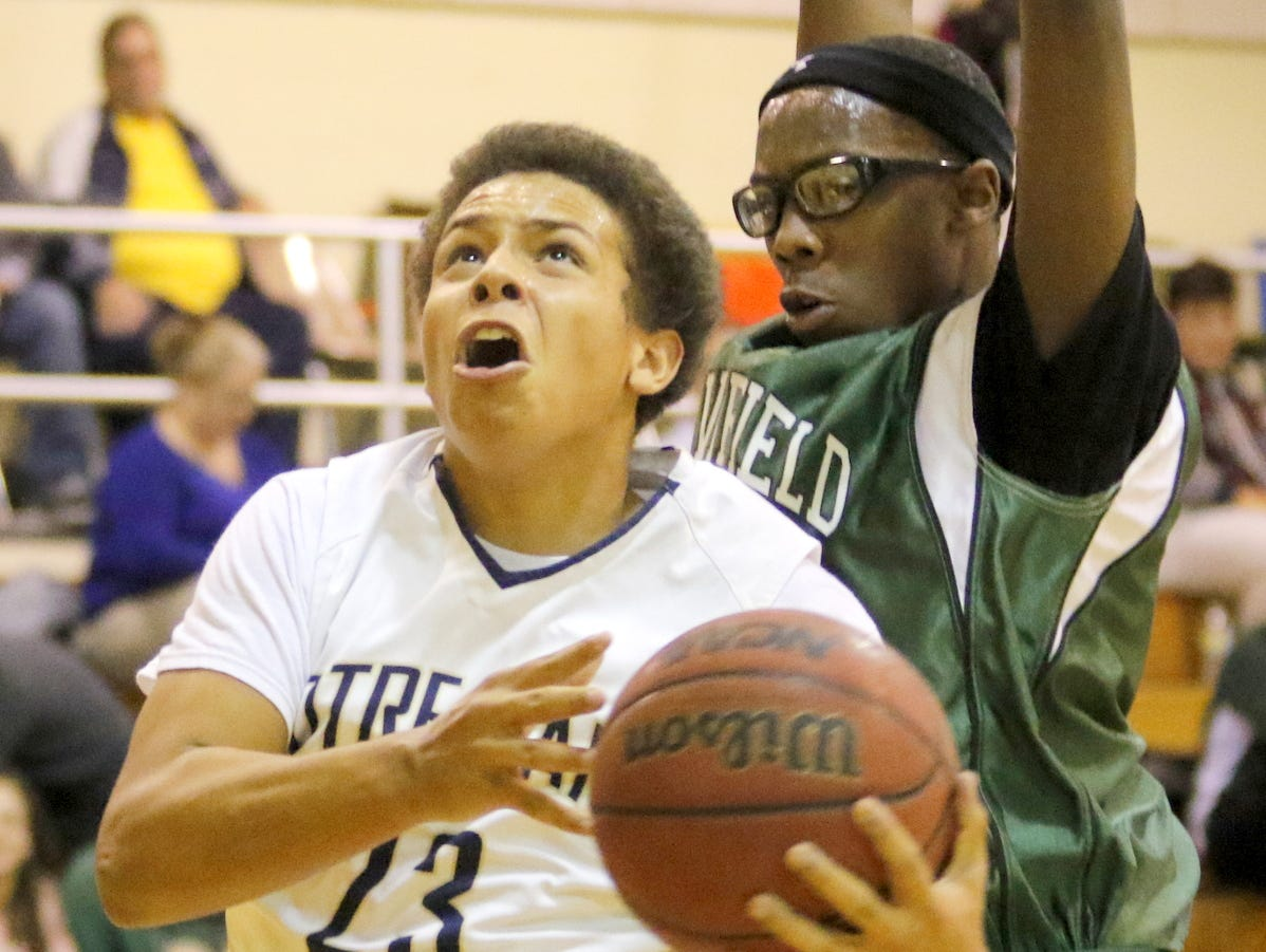 Notre Dame's Derrick Stark drives to the basket past Newfield's Quintel Clements during Friday's IAC game in Southport.