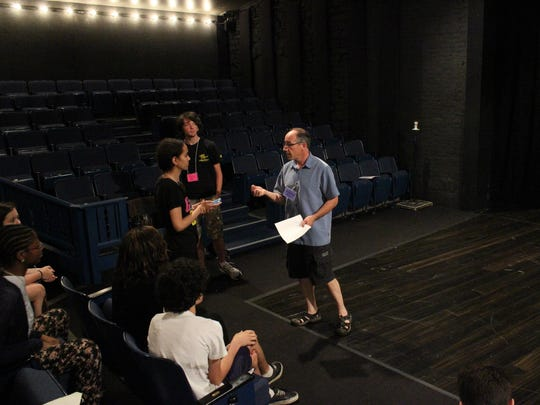 Students in grades 9-12 working on monologues with actor Michael G. Bath on the stage of the Playhouse in the Park's Thompson Shelterhouse Theatre. Bath is one of nearly two dozen theater professionals who are part of the Playhouse's summer camp for students in grades 1-12, which runs through July 31.