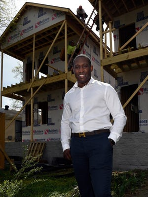 D.J. Wootson, owner of Titus Young Real Estate, visits the site of one of the homes he is building on Scovel Street on April 1, 2016.