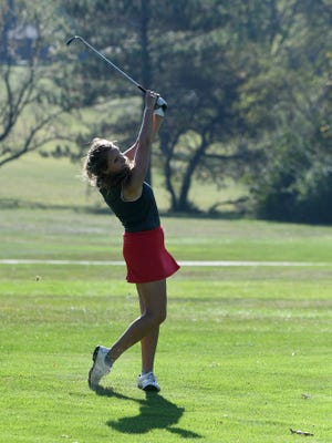 Shelby's Claire Korbas hits an approach shot during Tuesday's Division II sectional girls golf tournament at Valley View. Korbas shot a 76, with four birdies, to take medalist honors.