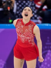 Mirai Nagasu of the United States celebrates after her performance in the ladies single skating free skating in the Gangneung Ice Arena at the 2018 Winter Olympics in Gangneung, South Korea, Monday, Feb. 12, 2018. (Paul Chiasson/The Canadian Press via AP)