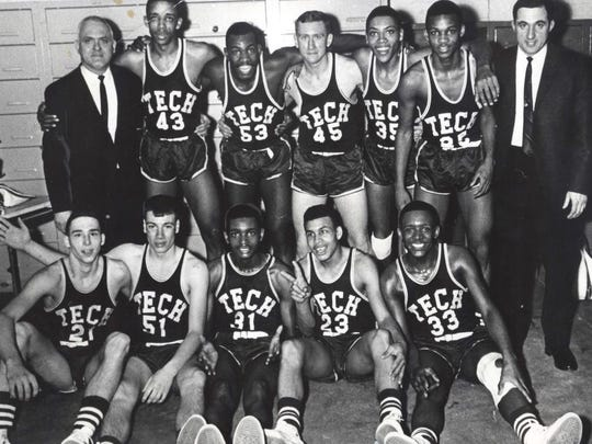 Tech Titans, 1966. In this Feb. 7, 1966 photo, the Titans had just defeated Cathedral for the Hinkle Fieldhouse sectional championship. Front row - Ross Furry, Joe Henderson, MIke Price, Glen Johnson and Jim Price Back row - coach Jack Bradford, Warren Marsden, Chick Sanders, Steve Sanders, Otis Curry, Gerald Sears and Asssistant Coach Carl Meditch.