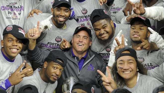 Alcorn State coach Jay Hopson, center, celebrates with his team after beating Grambling for a second consecutive SWAC championship. Hopson and the Braves have been a perfect match since he took over in May 2012.