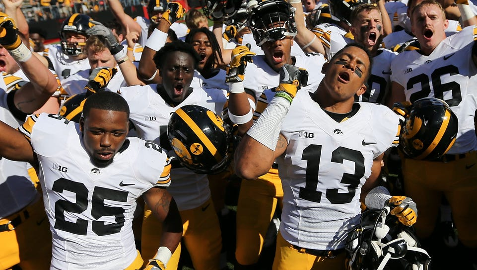 Iowa players celebrate with their traveling fans after