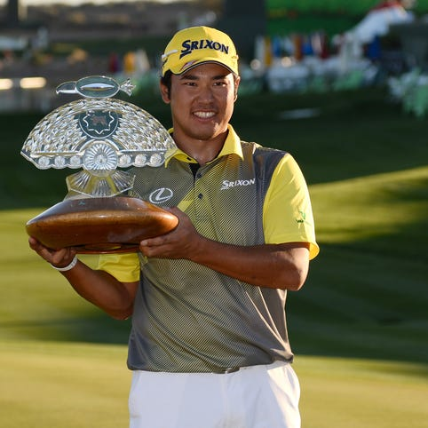 Hideki Matsuyama poses with the trophy after the final round of the Waste Management Phoenix Open at TPC Scottsdale on Feb. 7, 2016.