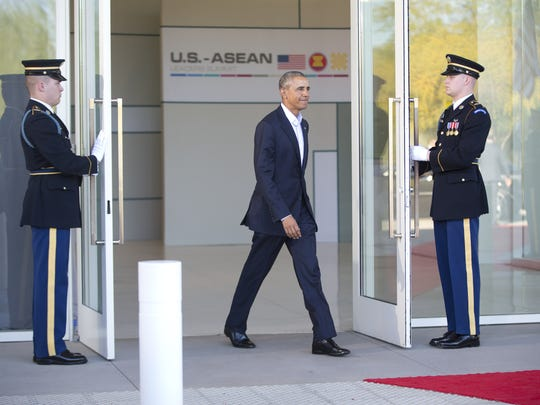 President Barack Obama walks out to greet leaders of