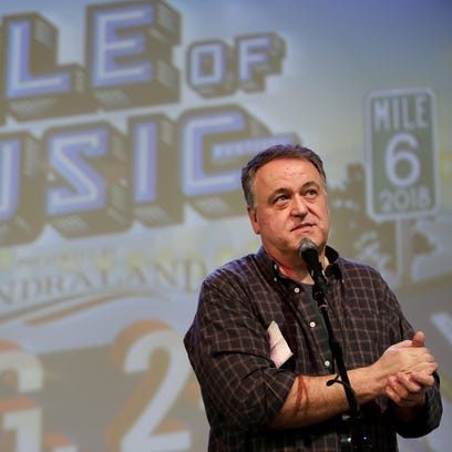 Mile of Music co-founder Dave Willems speaks to a gathering