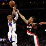 Mar 24, 2016; Los Angeles, CA, USA; Los Angeles Clippers guard Chris Paul (3) attempts a shot defended by Portland Trail Blazers guard Damian Lillard (0) during the second half at Staples Center. The Clippers won 96-94. Mandatory Credit: Kelvin Kuo-USA TODAY Sports