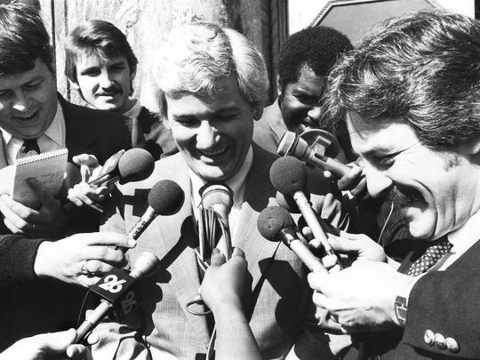 In a Feb. 21, 1984, photograph, bankrupt financier Jake Butcher talks to the press outside the federal courthouse after turning over business records connected to the collapse of the United American Bank chain to a federal grand jury. His attorneys argued that Butcher's right against self-incrimination would be violated by turning over the records. At left is Knoxville Journal, and later News Sentinel, reporter Bob Womack.