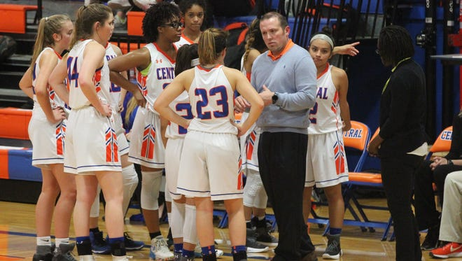 Central High School head coach Landon Dyer goes over things with the Lady Cats during a game against Killeen Shoemaker in the District 8-6A opener at Babe Didrikson Gym on Friday, Dec. 8, 2017. Central won 42-26.