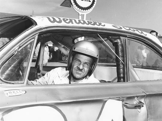 Wendell Scott poses for a portrait in his car as he became the first African-American driver to win in the NASCAR Cup division with a victory in 1963 at Jacksonville Speedway Park in Jacksonville, Fla. Scott was NASCAR's first black competitor, starting in the sportsman class in 1953.