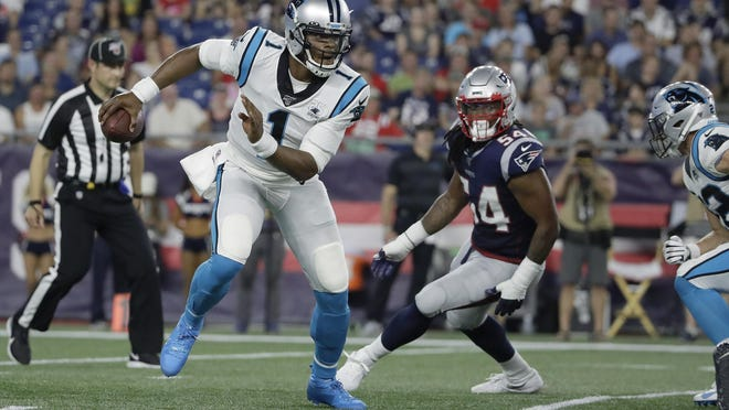 Panthers quarterback Cam Newton, left, scrambles away from Patriots  linebacker Dont'a Hightower during a preseason game on Aug. 22. The two players will now be teammates.