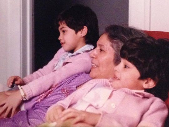 Nicole Martinez-LaGrande (far right) with her grandmother