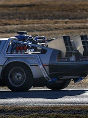 "Matt Hissem drives his 1981 DeLorean. Hissem has converted the iconic car into a detailed replica of the DeLorean time machine from the ""Back to the Future"" movies."