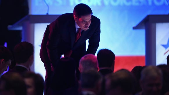Marco Rubio talks to audience members during a commercial