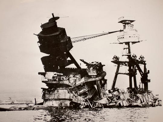 The toppled superstructure of the USS Arizona.