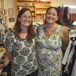 (From left) Sisters, Jessica Salyer and Kim Youngken, both of Palm Bay, recently opened Paw Prints and Fish Tales