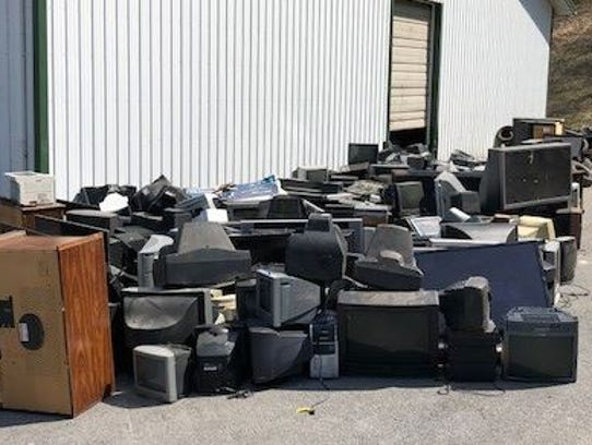 Old televisions are piled up outside the Washington