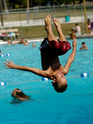 Dominic Carter of De Pere does a flip at the Legion Park Swimming Pool in this 2007 file photo.