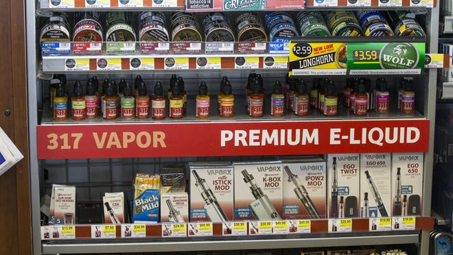 Oils used in vaping devices, along with smokeless tobacco, are on sale at the Ricker's at East Hanna Avenue and South East Street in Indianapolis.