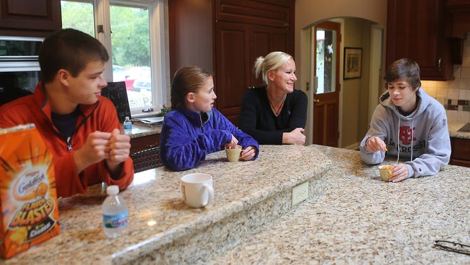 Crysta Pleatman talks with her kids, from left, Woody, 19, Gabby, 11, and Parker, 16, at their home in Indian Hill.