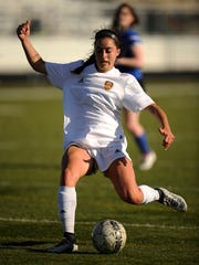 Wylie's Gracie McCaslin (4) takes a shot during the