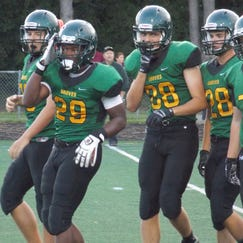 Birmingham Groves raced to its third straight victory of the 2014 season Friday at Southfield-Lathrup.