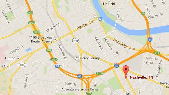 Marker shows the location of a shooting that injured a 22-year-old man on Saturday, April 25, 2015.