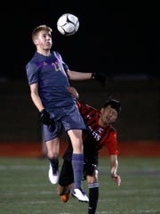 Norwalk sophomore Benjamin Topliff heads the ball in front of Des Moines East freshman Erick Rodriguez. Norwalk beat Des Moines East 2-1 in a March 28 home game resolved by penalty kicks.