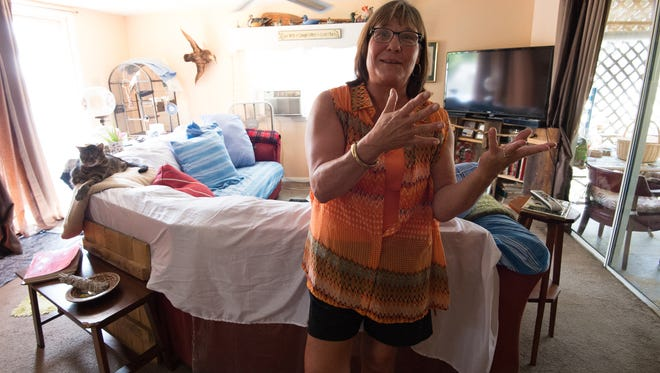 Melanie Breech, 55, is shown at her home in Millsboro on Friday. The former receptionist at Ocean View Town Hall lost her job after a drug test turned into a legal battle over medical marijuana.