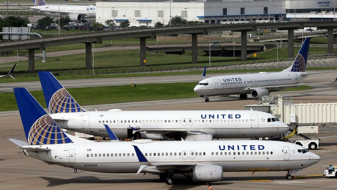 United Airlines planes at George Bush Intercontinental Airport in Houston on July 8, 2015. A video posted on Facebook on Sunday, April 9, 2017, shows a passenger on a United flight from Chicago to Louisville being forcibly removed from the plane.