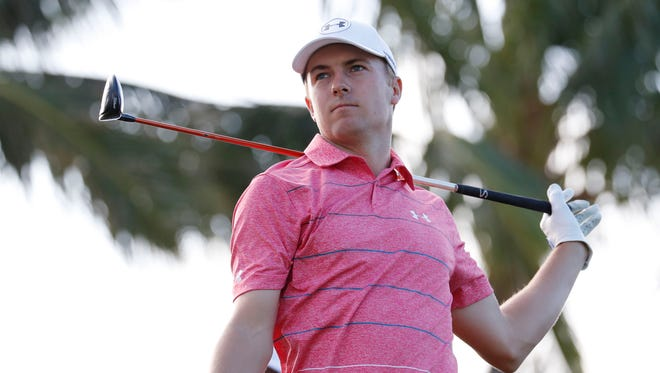 PGA golfer Jordan Spieth tees off on the 14th hole during the first round of the Sony Open golf tournament at Waialae Country Club.