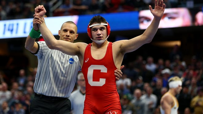 Mar 17, 2018; Cleveland, OH, USA; Cornell wrester Yianni Diakomihalis reacts after defeating Wyoming Cowboys wrestler Bryce Meredith  during the NCAA Wrestling DI Wrestling Championships at Quicken Loans Arena. Mandatory Credit: Aaron Doster-USA TODAY Sports