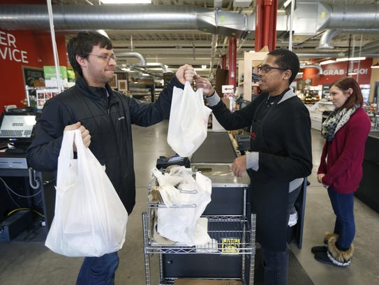 Carl Galland of Rochester picks up his groceries from