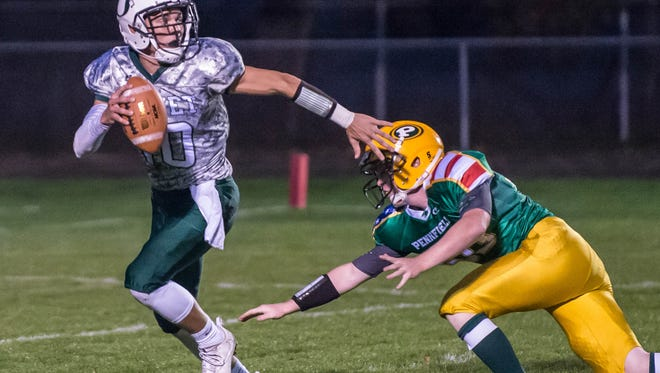 Olivet's Bradley Sinclair is pressured against Pennfield Friday evening.
