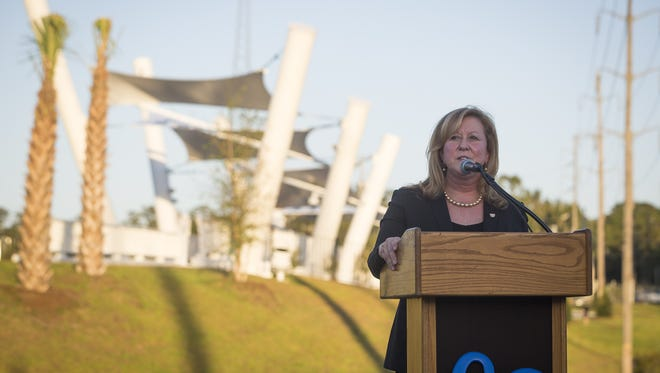 Linda Figg, president and CEO of FIGG Bridge Group, called the Capital Cascades Crossing Bridge the most eco-friendly pedestrian bridge in the country at the walkway's grand opening on Monday. Figg's firm designed the bridge.