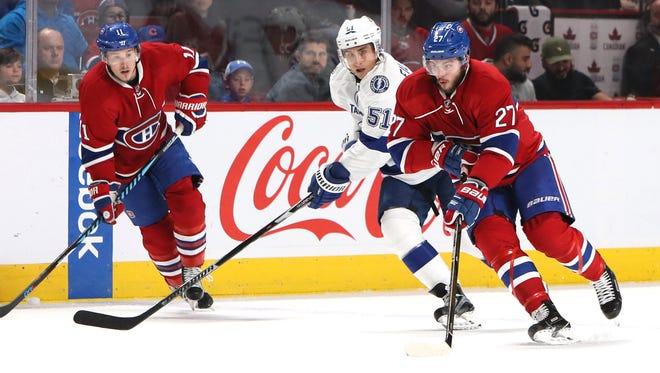 Canadiens center Alex Galchenyuk plays the puck against Lightning center Valtteri Filppula at Bell Centre.