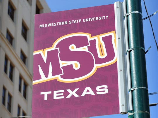 One of 17 MSU Texas banners installed in the downtown area Thursday morning. The banners increase visability for the school and will help draw students downtown.