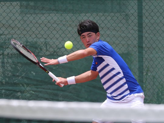 No. 4 Soichiro Moritani of Japan prepares for a forehand return against Korea Republic's Kwon Oh-Hee in a Day 4 singles match of the 2017 King's Guam Futures tennis tournament, an ITF Pro Circuit event presented by Docomo Pacific and Hilton Guam Resort & Spa Thursday at the Hilton tennis courts. Moritani won 6-2, 2-6, 6-3.