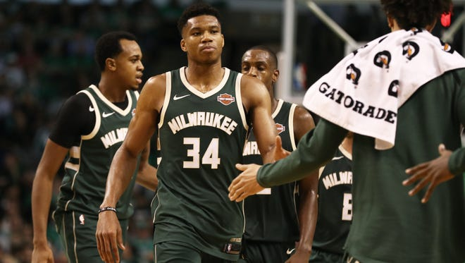 Giannis Antetokounmpo walks back to bench during a timeout late the fourth quarter with the Bucks holding a lead they would not relinquish against the Celtics on Wednesday night. Antetokounmpo produced game-highs of 37 points and 13 rebounds in leading Milwaukee to a season-opening victory.