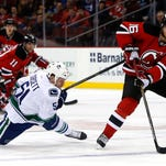 New Jersey Devils center Jacob Josefson (16) skates