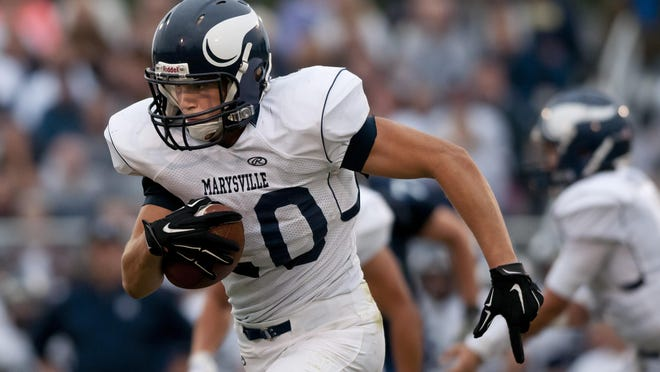 Marysville's Ryan Ellul runs the ball down field during a game this season.