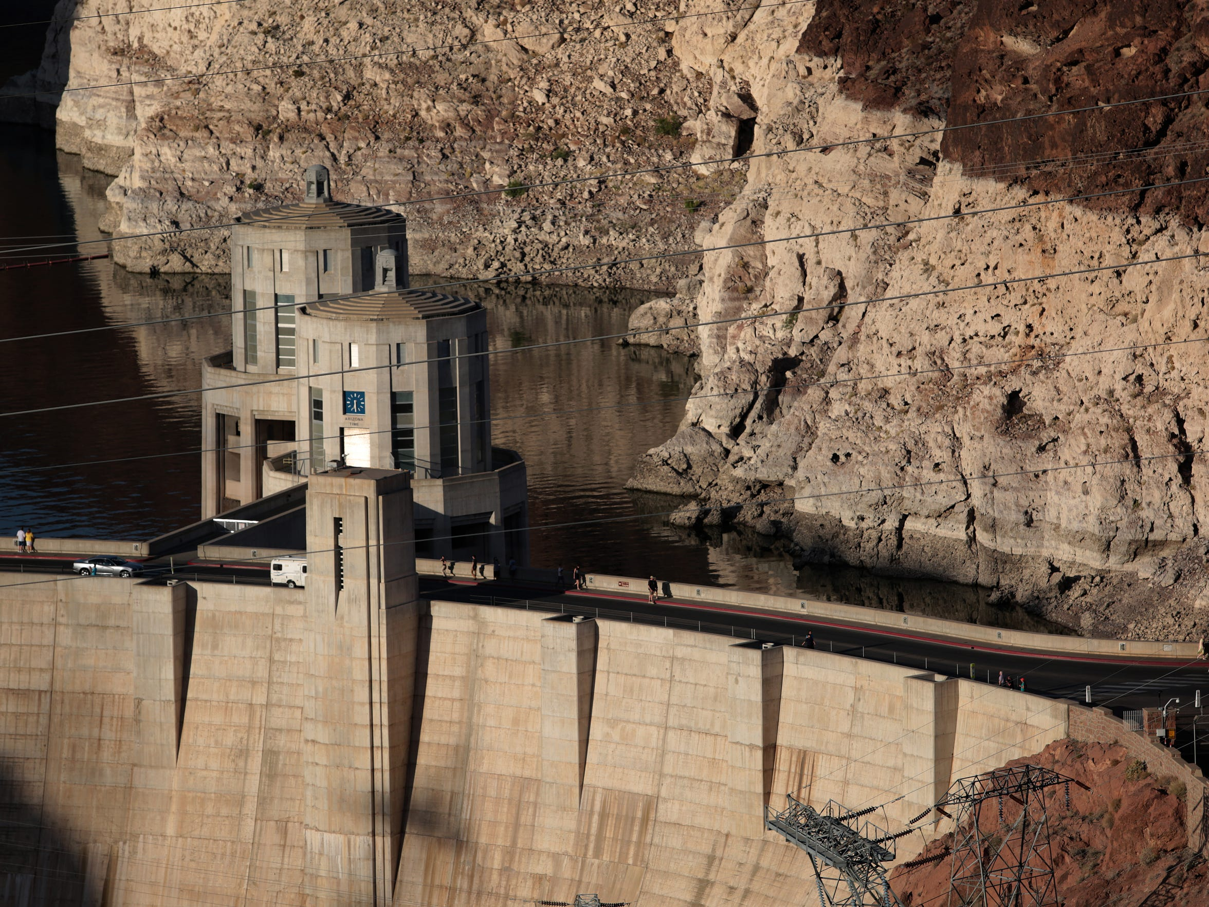 Hoover dam rises above Lake Mead, which has recently