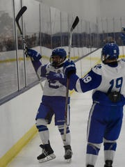 Catholic Central's Brendan West celebrates with Carter