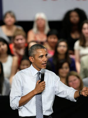 President Obama speaks during a town hall meeting, Monday in Des Moines, Iowa.