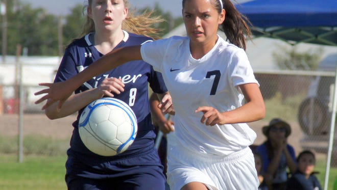 Junior Lady Cat Joanna Barrajas (7) is in pursuit of a free ball during Tuesday's season-opening home soccer match against visiting Silver High. Deming lost the match 2-1 on an own-goal in overtime.